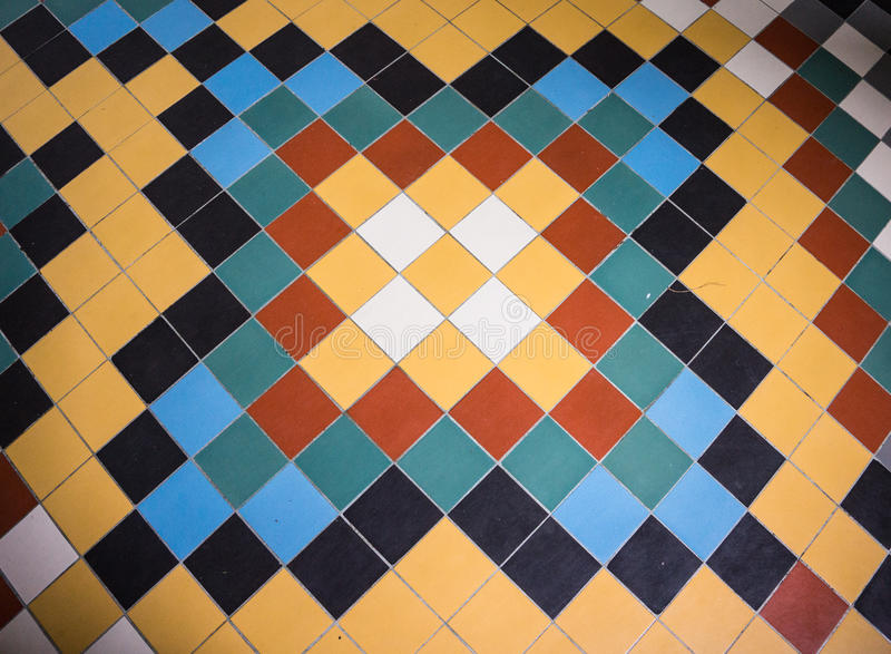 Pattern on tile floor in Art Deco style and colors. Geometric and colorful tile floor pattern on hallway floor of Benedictine Abbey built in 1932 in Art Deco stock photos