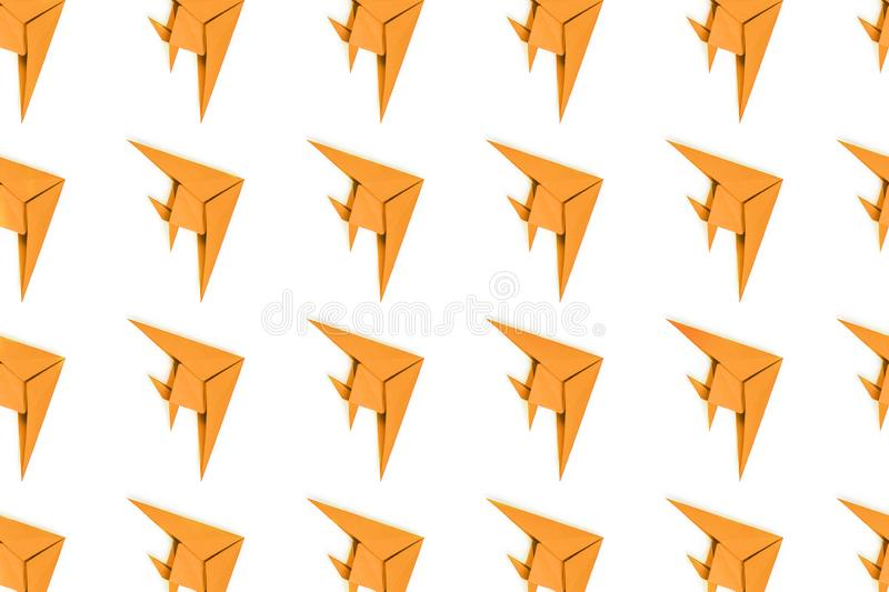 Paper origami fishes isolated on white background. Pattern of turmeric paper origami fishes isolated on white background royalty free stock image