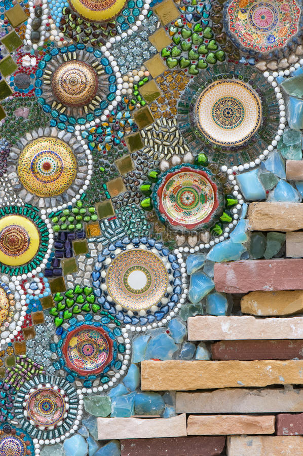 Pattern of the wall. Colorful pattern of the wall made from ceramic bowl,crystal and marble stock images