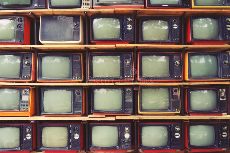 Pattern wall of pile colorful retro television TV. Vintage filter effect style royalty free stock images