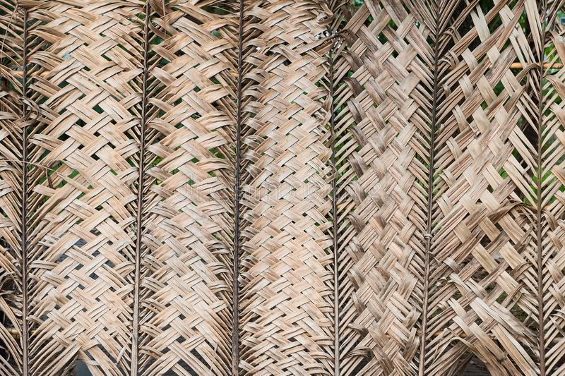 Pattern weaving of coconut leaves for background royalty free stock image