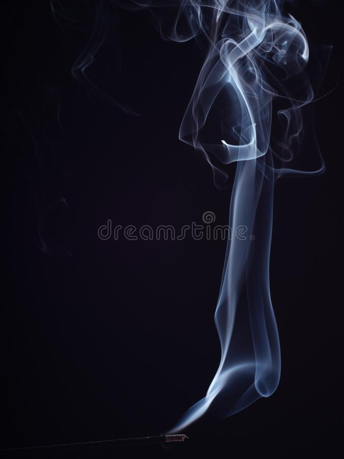 Pattern of white smoke  on black background, close up view. Structure of white smoke, brush effect. Burning. Incense for meditation and relaxation, abstract stock photos
