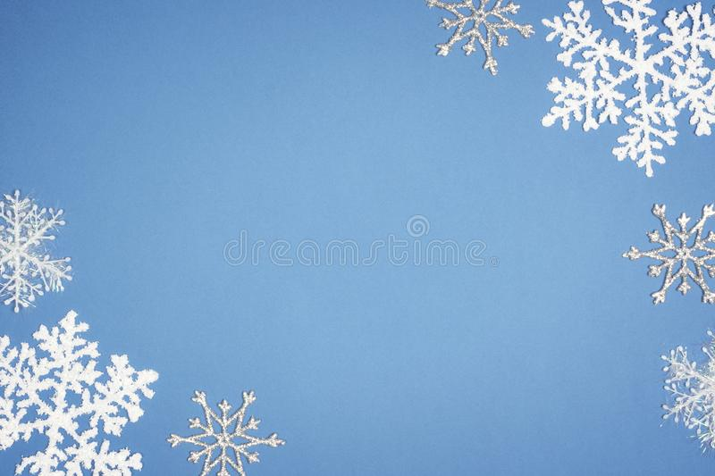 Pattern white snowflake on blue background. Christmas decor with Copy space.  royalty free stock image