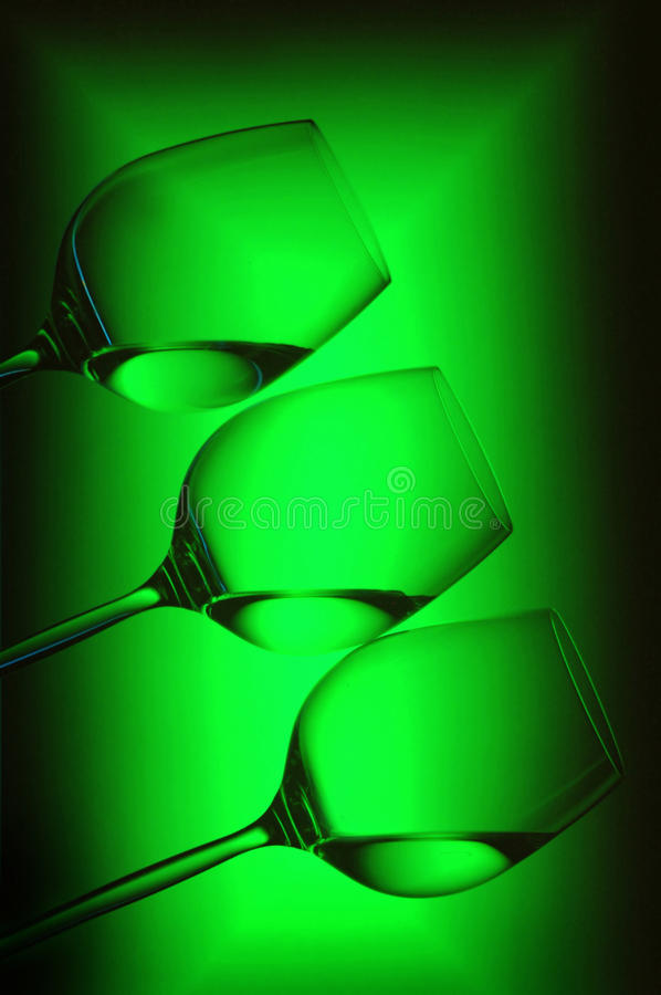 Pattern of wine glasses. Diagonal pattern of wine glasses with background reflections stock photos