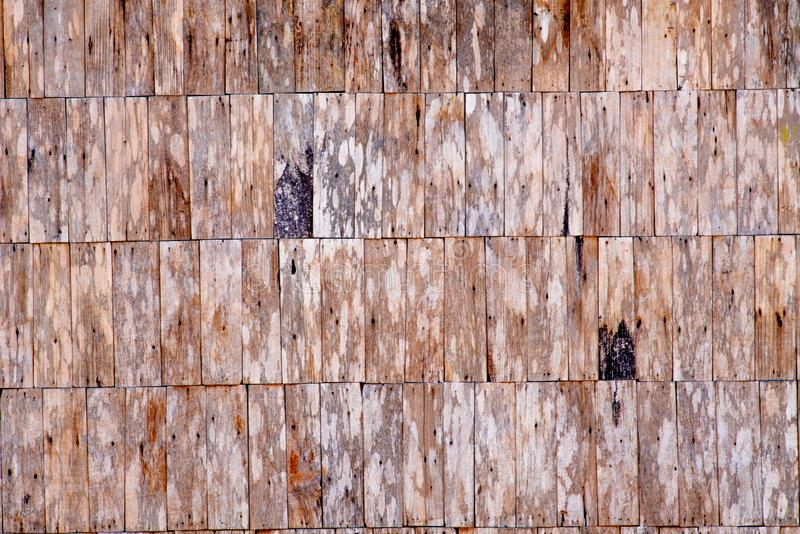 The pattern of wooden slat wall with rough surface. Wooden slats are used to build a unique wall of a villager`s house in the north of Thailand stock images