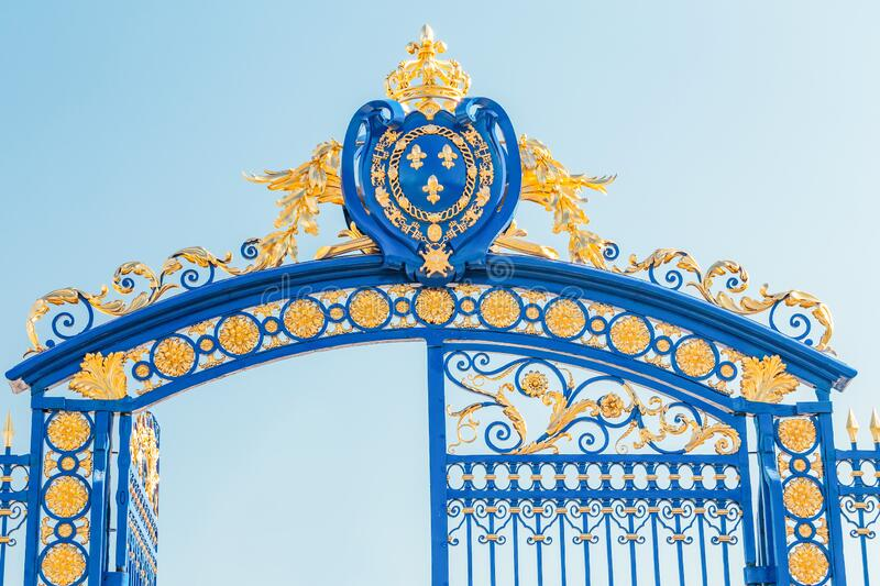 Patterned blue fence with the entrance gate to the Invalides In Paris royalty free stock images