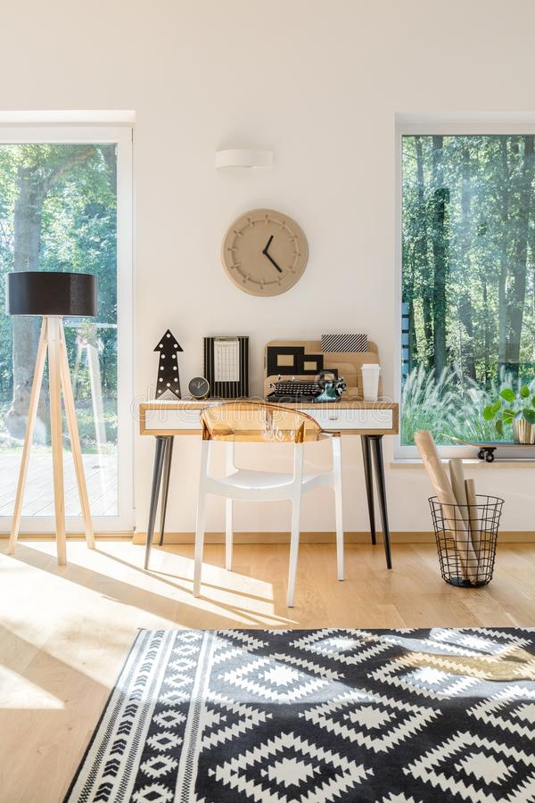 Scandinavian style workspace with clock royalty free stock photography