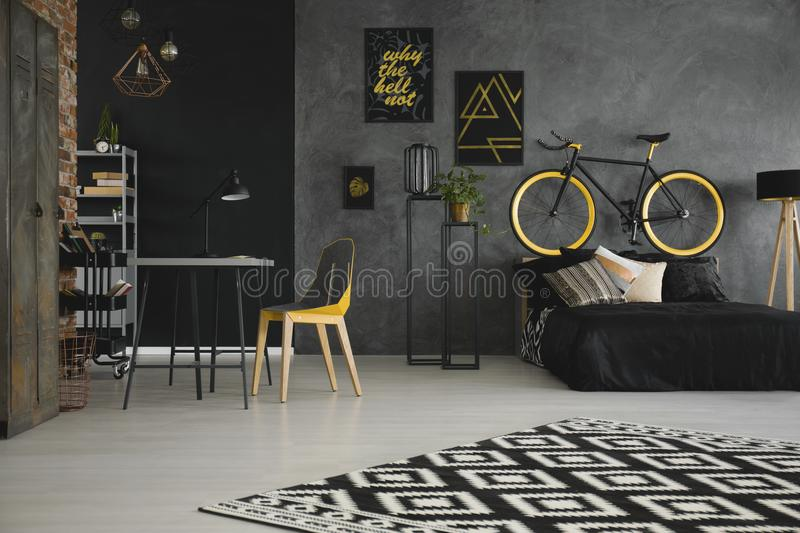 Patterned carpet in teenager`s room interior with yellow chair a stock photo