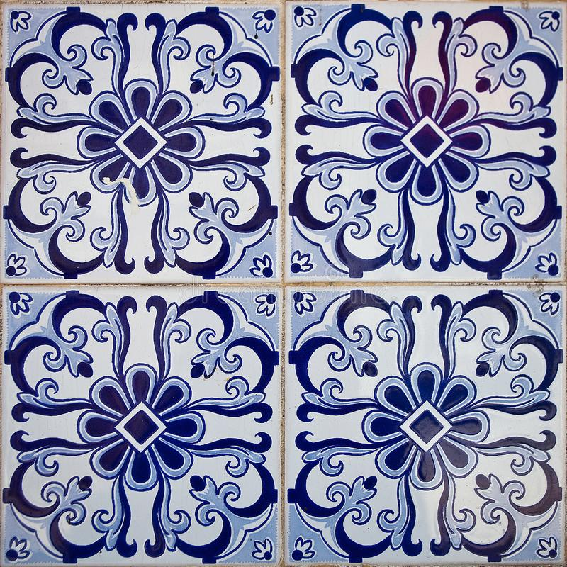Patterned colored tiles on houses symbol of Lisbon. Abstract, ornament, European authentic style stock photography