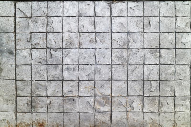 Patterned paving tiles cement brick floor background stock photos