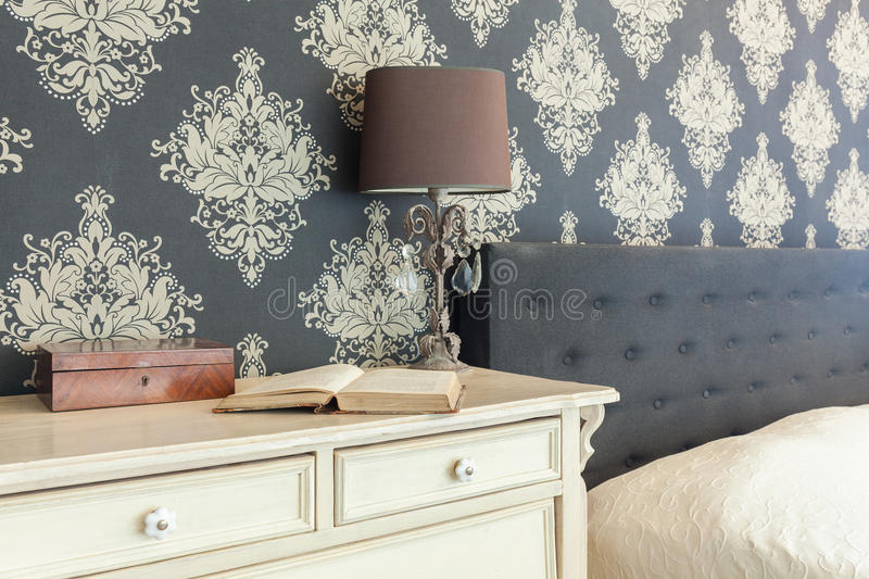 Patterned wallpaper in retro interior royalty free stock photo