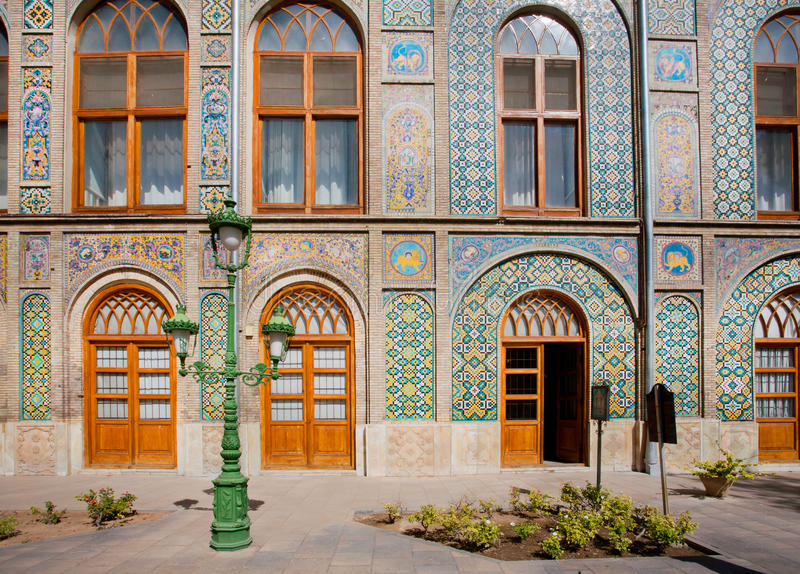 Patterned walls and wooden doors of the royal palace Golestan in Tehran, Iran. Golestan Palace is the oldest groups of buildings in persian capital, was royalty free stock image