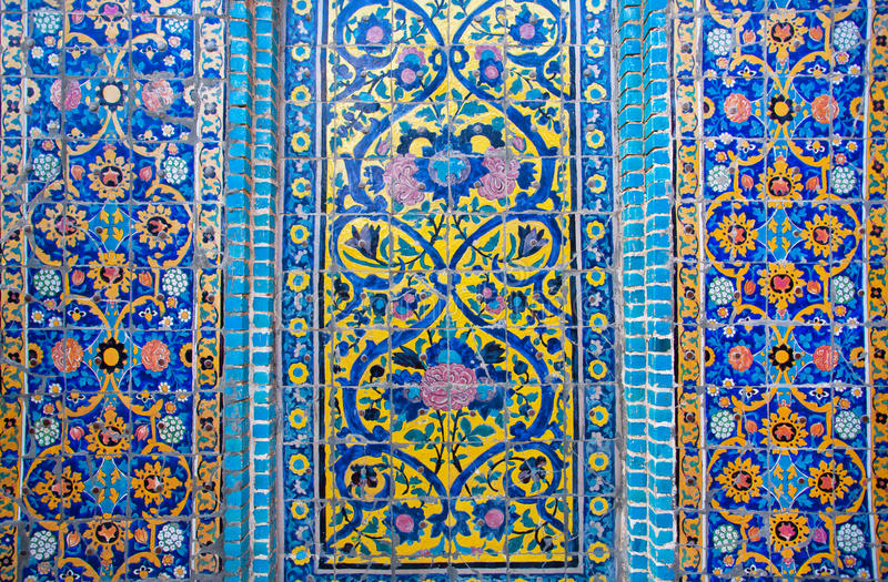 Patterns on a crumbling tile of beautiful persian Palace royalty free stock photos