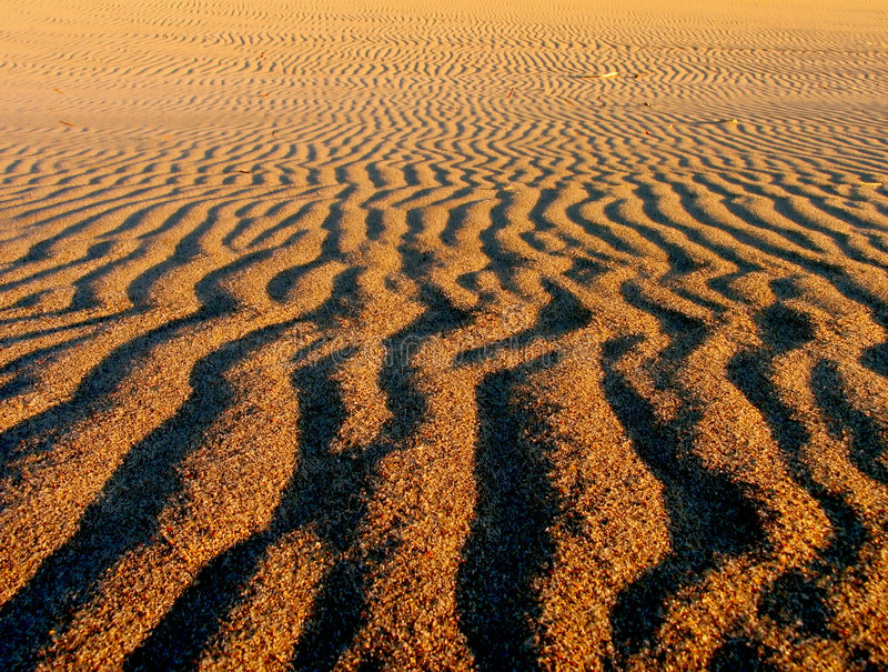 Patterns on sand stock photos