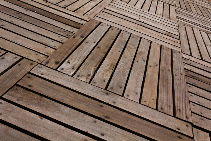 Patterns and textures of a wooden planks. Pavement royalty free stock photos