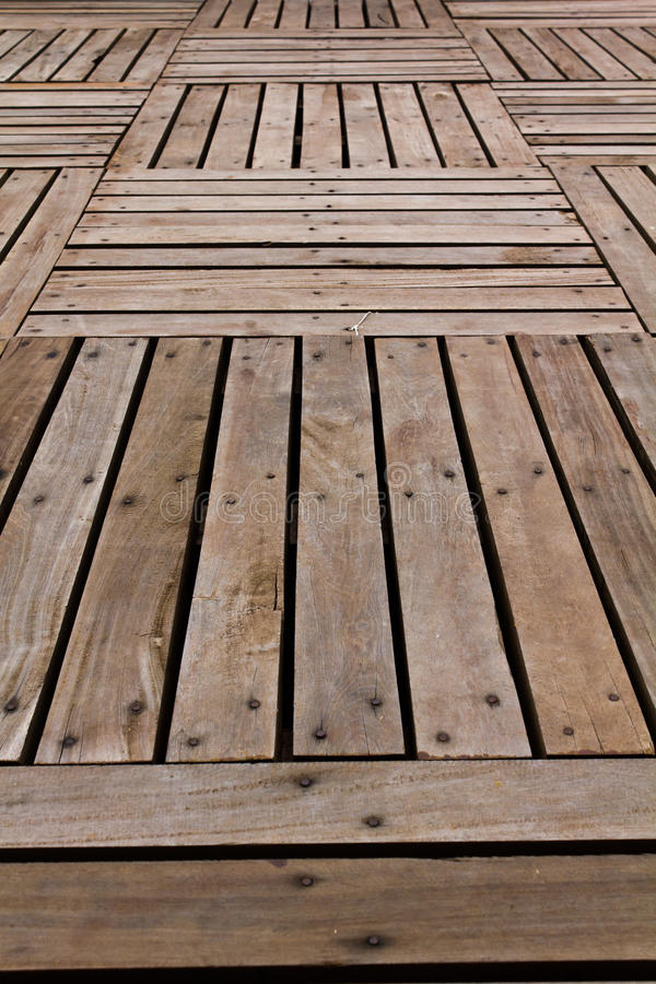 Patterns and textures of a wooden planks. Pavement stock photography