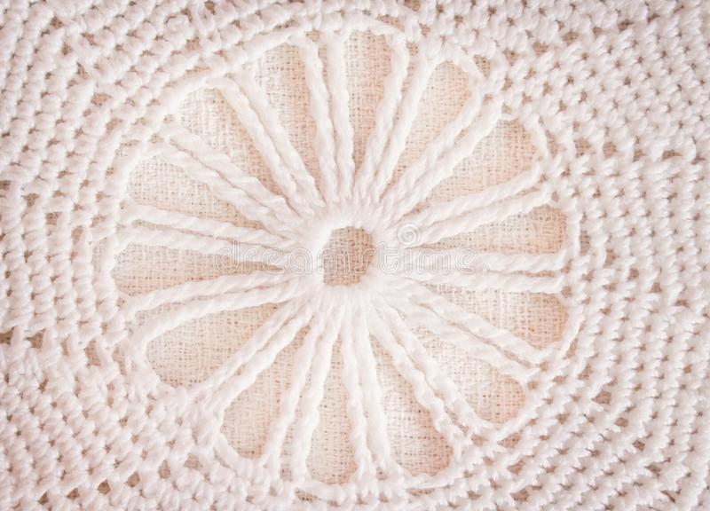 Patterns of white or light brown crochet knitted texture in flowers patterns for background , crafts stock image