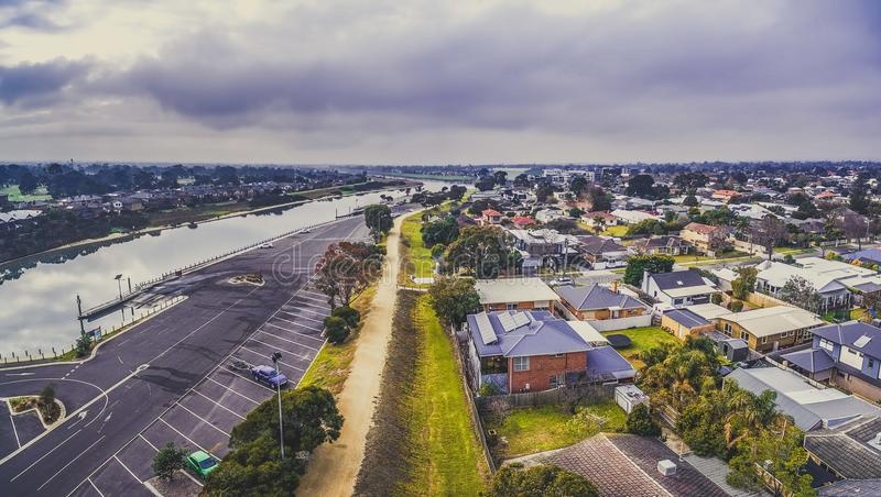 Patterson river and suburban homes. Patterson river and suburban homes on its shores. Carrum, Melbourne, Australia royalty free stock photos