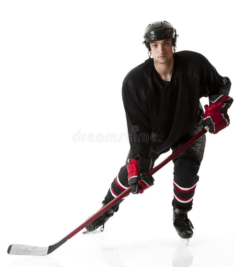 Pattinare del giocatore di hockey su ghiaccio fotografia stock libera da diritti