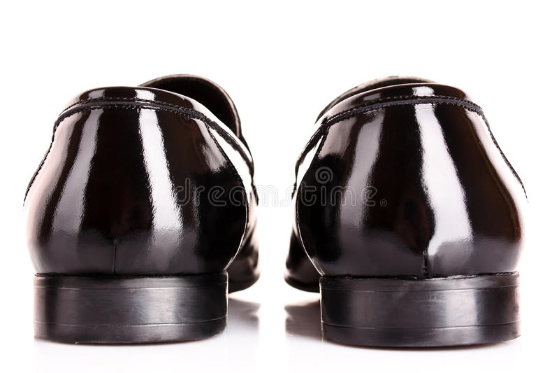 Pattino dell'uomo lucido nero isolato fotografia stock