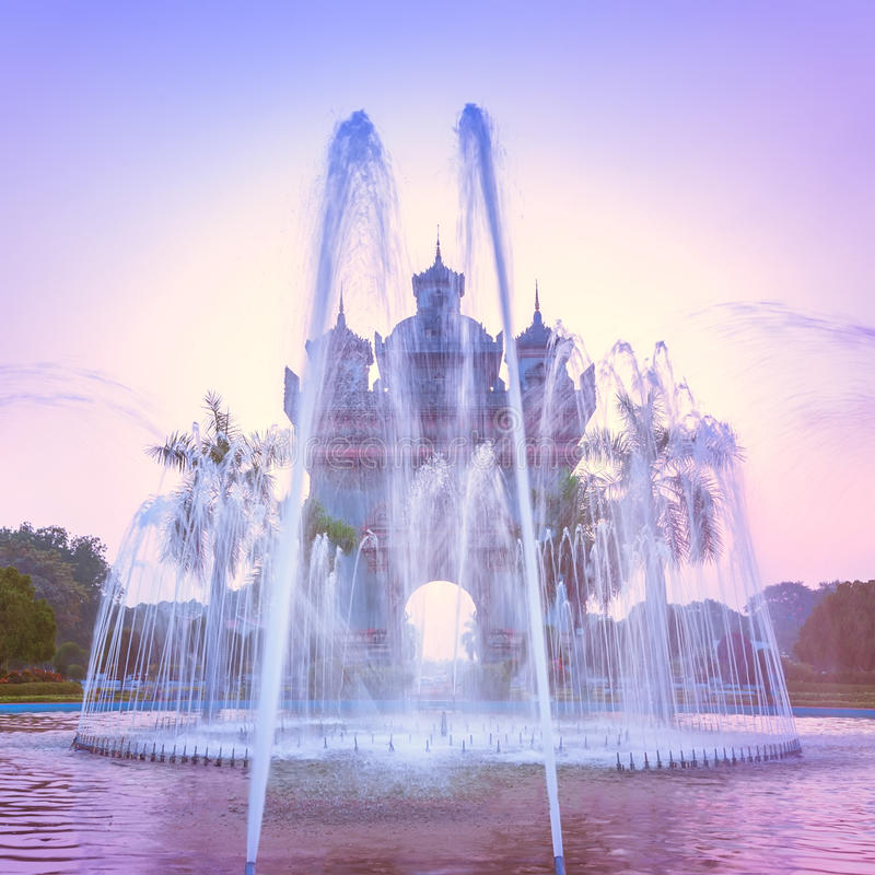 Patuxai arch or Victory Triumph Gate monument with fountain in front. Vientiane, Laos. Sunset view of Patuxai arch or Victory Triumph Gate monument with fountain royalty free stock image