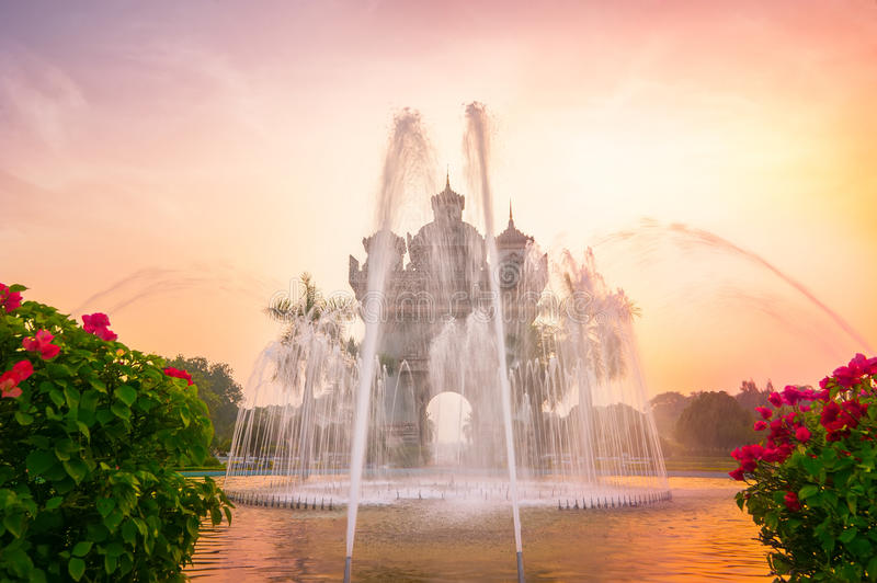 Patuxai arch or Victory Triumph Gate monument with fountain in front. Vientiane, Laos stock photo