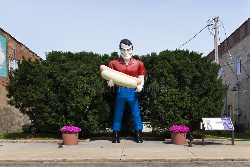 Paul Bunyan holdign an hot dog statue in the US Route 66 in Atlanta, Illinois, USA. Atlanta, Illinois, USA - July 5, 2014: The Paul Bunyan holdign an hot dog royalty free stock photography