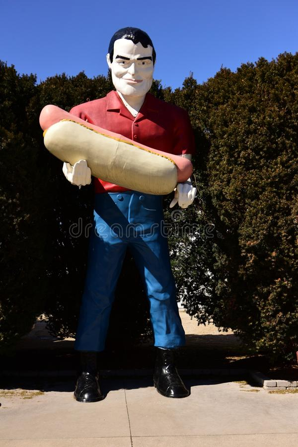 Paul Bunyan and a Hotdog. This is a Winter picture of the iconic Paul Bonyon not Bunyan figure holding a hotdog off historic Route 66 in Atlanta, Illinois in stock photography