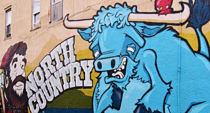 Paul Bunyan, Legendary Lumberjack. BEMIDJI, MN, USA - SEPTEMBER 23, 2017: Graffiti mural Paul Bunyan, Legendary Lumberjack and Babe The Blue Ox in Bemidji royalty free stock image