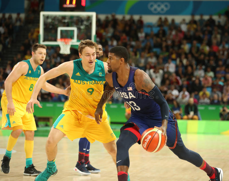 Paul George of team USA (R) in action during group A basketball match between Team USA and Australia of the Rio 2016. RIO DE JANEIRO, BRAZIL - AUGUST 10, 2016 stock images