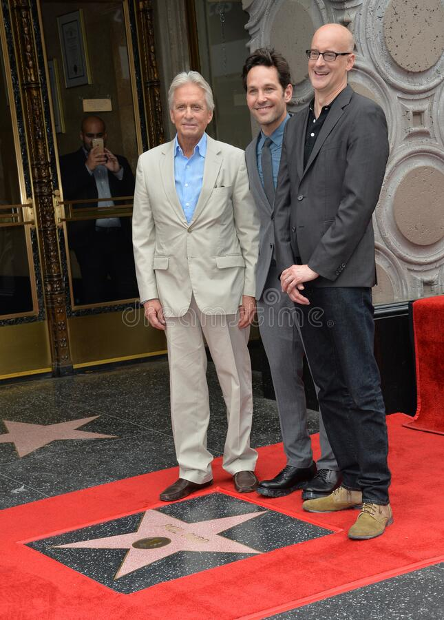 Paul Rudd & Michael Douglas & Peyton Reed. LOS ANGELES, CA - JULY 1, 2015: Actors Paul Rudd & Michael Douglas (left) & director Peyton Reed on Hollywood Blvd royalty free stock image