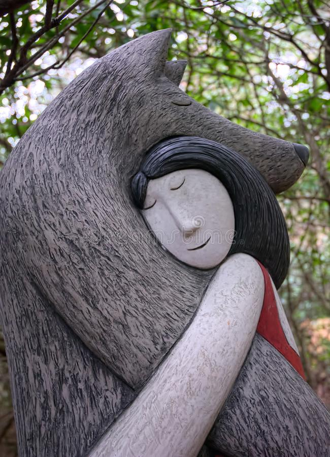 Bear Hug. Figurative sculpture by Paul Smith royalty free stock photography