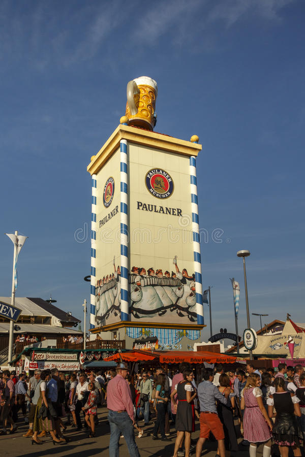 Paulaner tower at Oktoberfest in Munich, 2016. Munich, Germany - September 24, 2016: Roof of the Paulaner tower with the famous beer stein and unidentified stock images