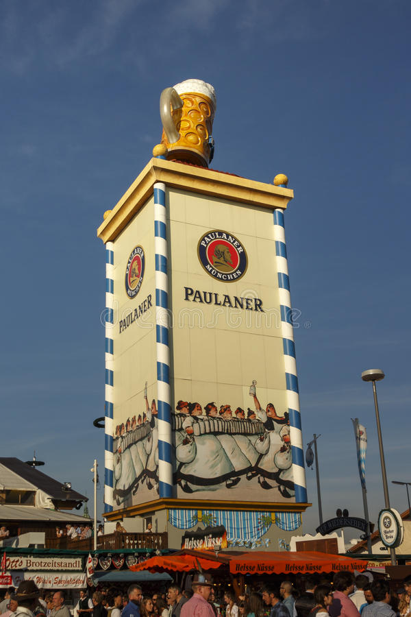 Paulaner tower at Oktoberfest in Munich, 2016. Munich, Germany - September 24, 2016: Roof of the Paulaner tower with the famous beer stein and unidentified stock photography