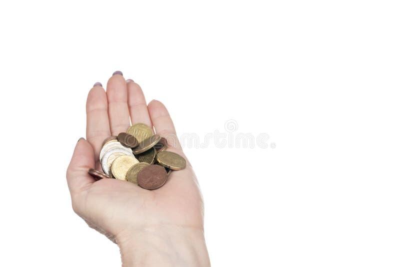 Paume femelle avec des pièces de monnaie photographie stock libre de droits
