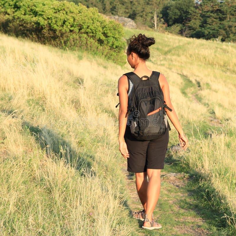 Girl walking on meadow in Divoka Sarka stock image