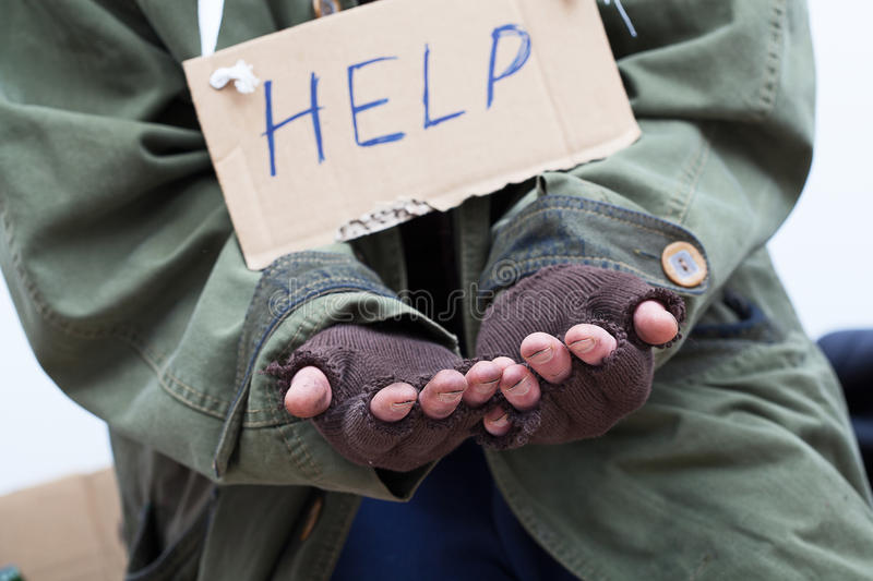 Pauper asking for help. Poor pauper begging for help royalty free stock photo