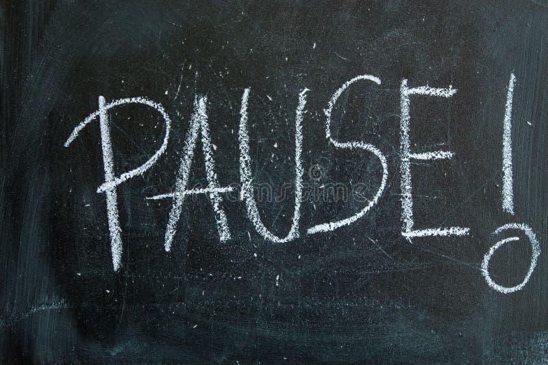 Paus som är skriftlig i krita på en svart tavla arkivfoto