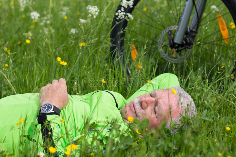 Pause of a cyclist stock images