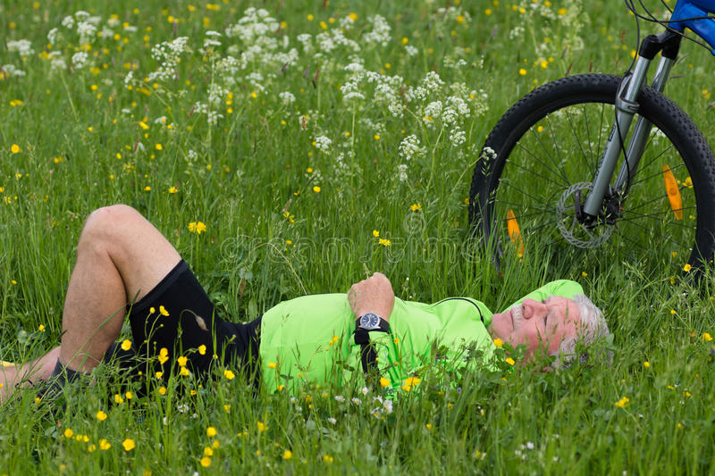 Pause of a cyclist stock photography