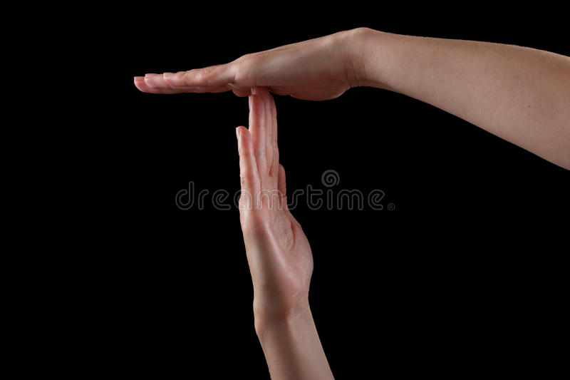Pause ou quebre o gesto de mão do tempo, tiro no preto fotos de stock