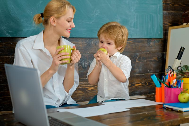 Pause. Snack. School break. The teacher and the boy eat together. After lessons. Lunch at school. Autumn education royalty free stock image