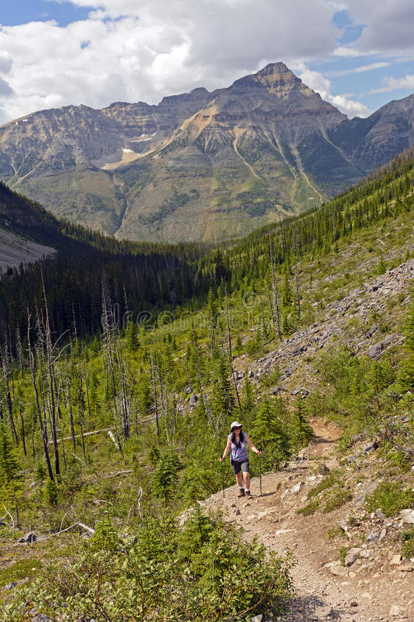 Pausing to enjoy the view on a mountain trail royalty free stock image