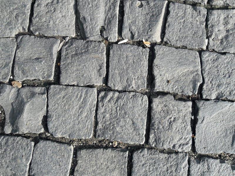Pavage en pierre de bloc images stock