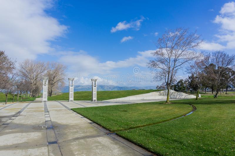 Paved path and art installation in Sunnyvale Baylands Park; Mission Peak in the background south San Francisco bay, California royalty free stock image