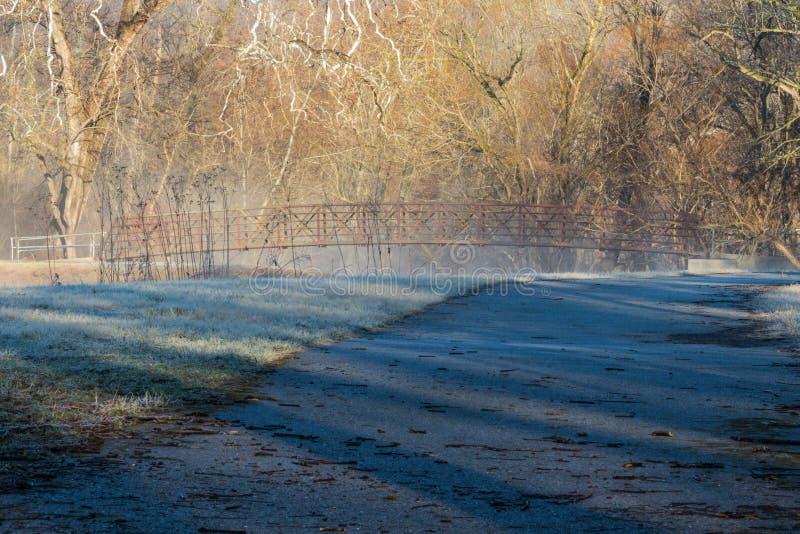 Pathway to metal bridge royalty free stock photo
