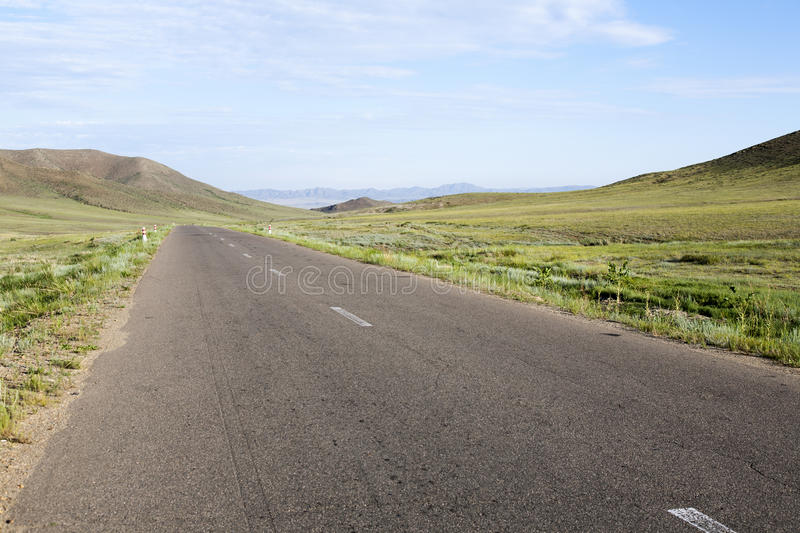 Download Paved Road Through Mongolian Steppes Stock Photo - Image of grass, highway: 36742930