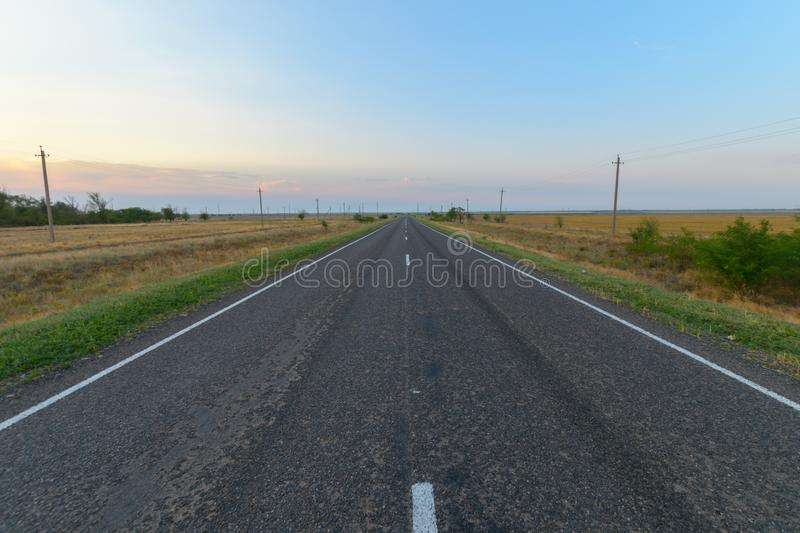 Paved road in the steppe. Horizontal royalty free stock photos