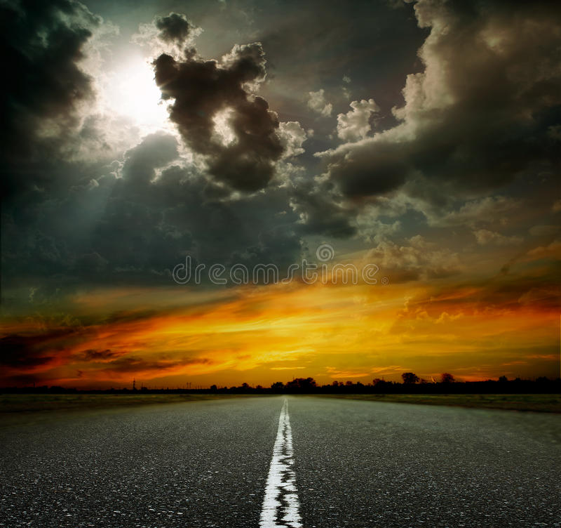 Paved road at sunset royalty free stock photo