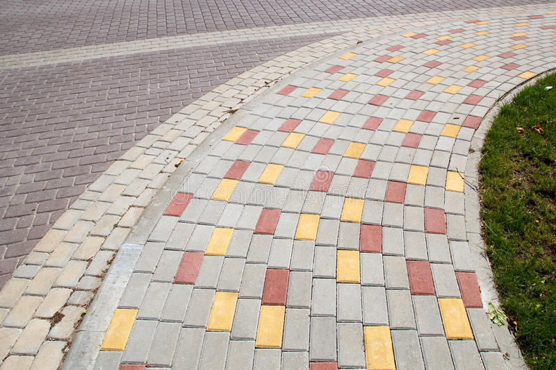 Paved sidewalk. From the colorful bricks stock photo